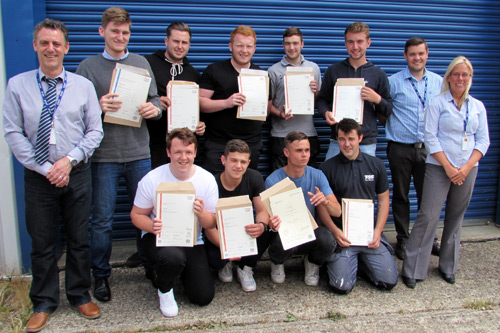 The graduates display their certificates