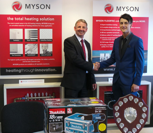 Alex (right) receives his award from Myson's regional sales manager, Nigel Stedman
