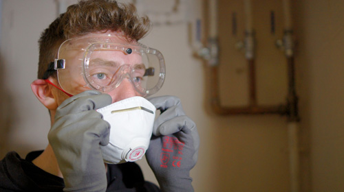 Installer wearing Graham Plumbers' safety goggles