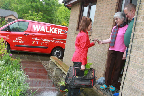 Walker home emergency plumber with customer