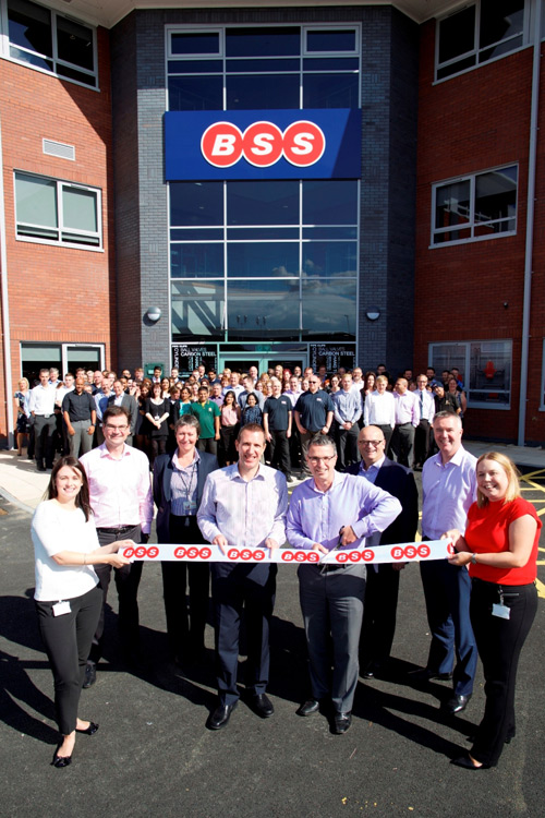 BSS managing director Chris Hufflett (centre left) and Travis Perkins, contract merchanting division, CEO Frank Elkins (centre right) cutting the ribbon on new HQ Boss Court.