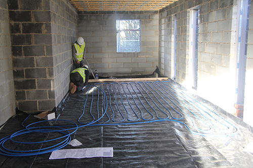 The donated OMNIE pipework system being laid down.
