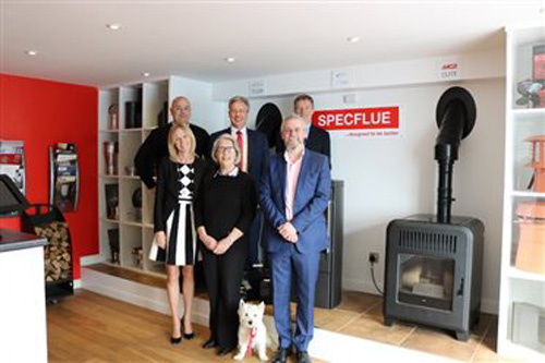 Back row: Lee George, operations manager, Ian Sams, commercial director, Richard Hall-Roberts, finance director. Front row: Jan Fry, managing director, Jeremy Fry, chairman, Shirley Williams, director, and Dave the dog