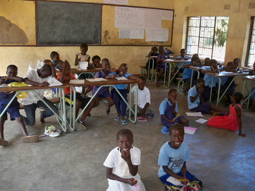 A typical classroom in this part of Zambia – too few desks, not enough of anything to help the children learn