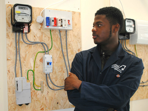 Engineering Diploma Level 3 student, William Nartey, in the new Smart Meter Installation Academy workshop at CONEL's Tottenham Centre.
