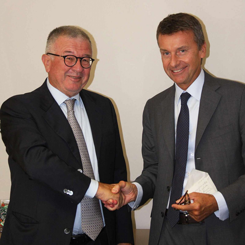 Alberto Cristina (left) and Marco Caleffi (right) shake hands on the acquisition of Cristina by Caleffi