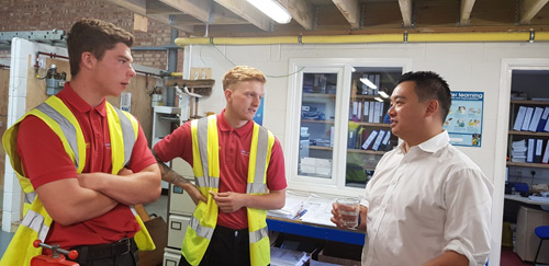 Aura Gas apprentices Billy Simmonds and Frankie Small chatting to Alan Mak MP